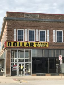 Photo of old brick building with large Dollar General Store sign